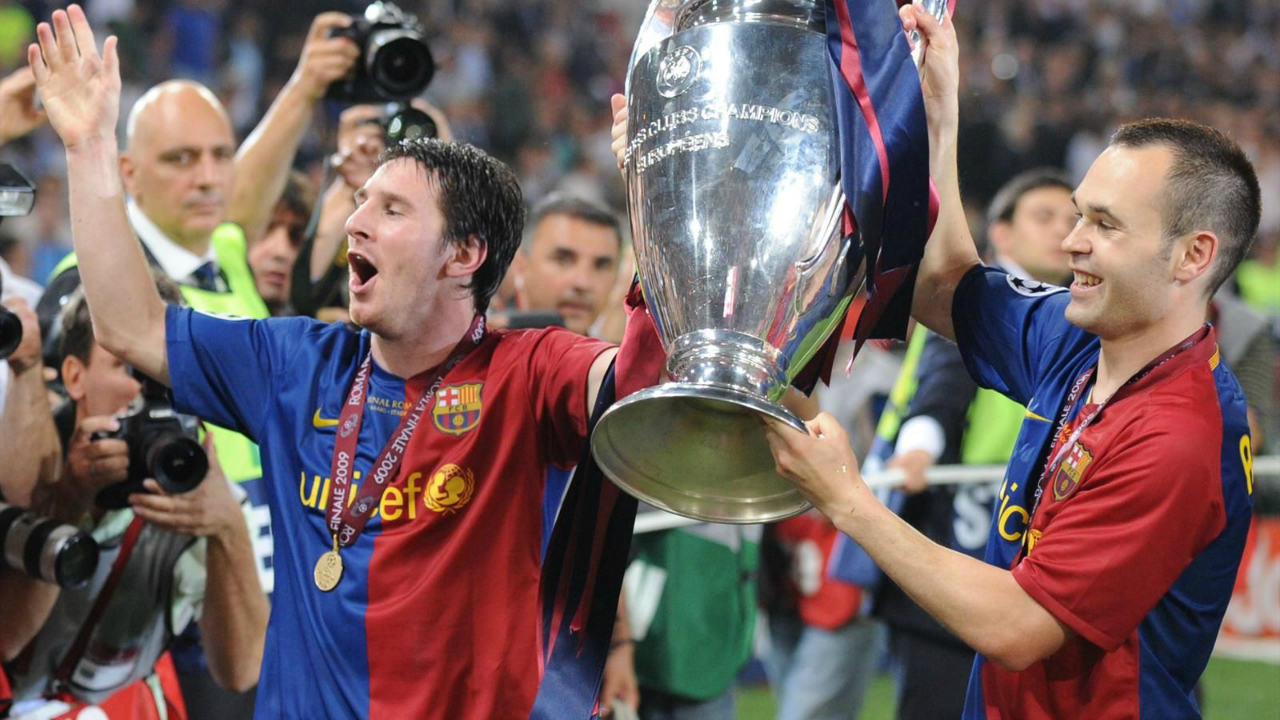 Messi Photos - Messi and Andres Iniesta hold up the 2009 Champions League trophy