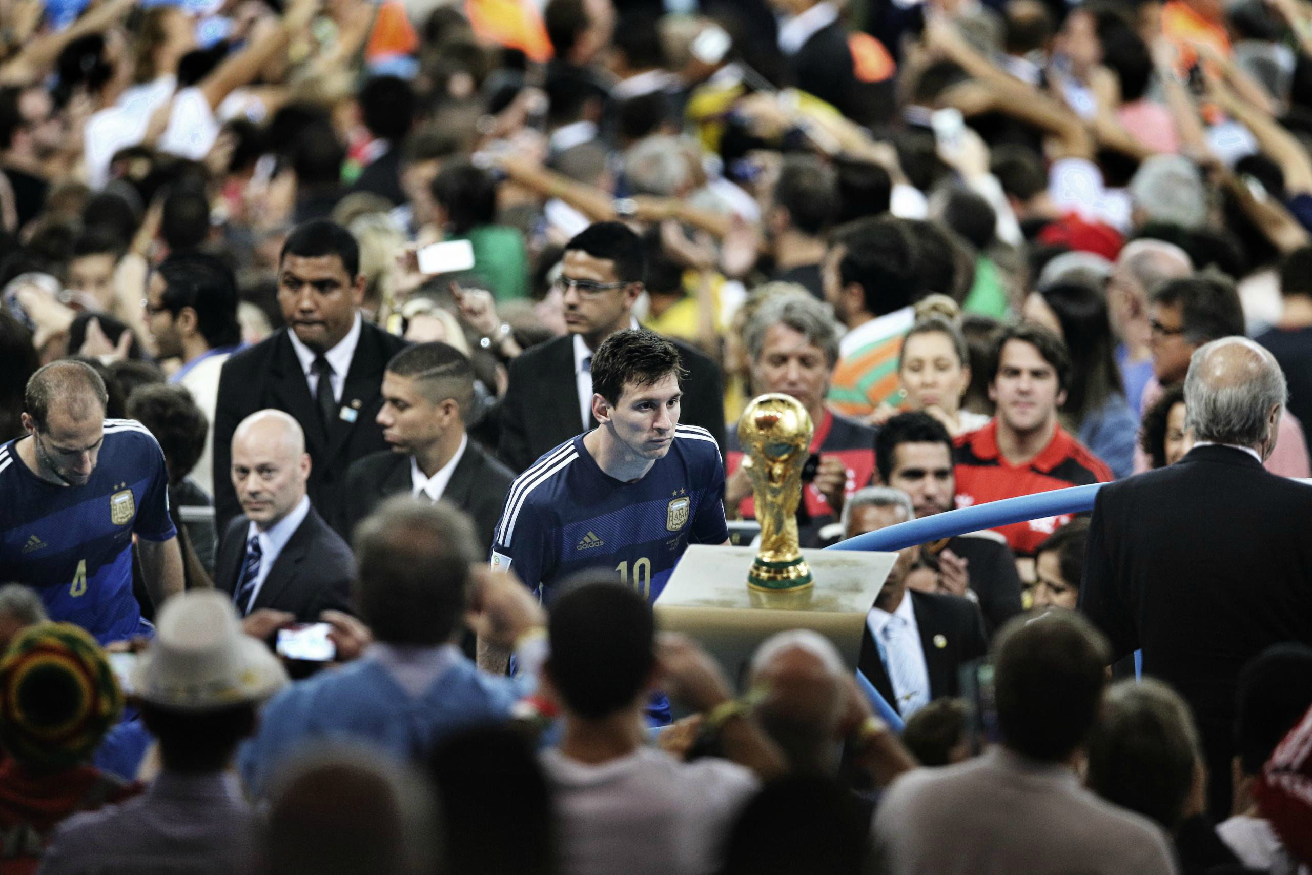 Messi Photos - Messi stares at the World Cup trophy