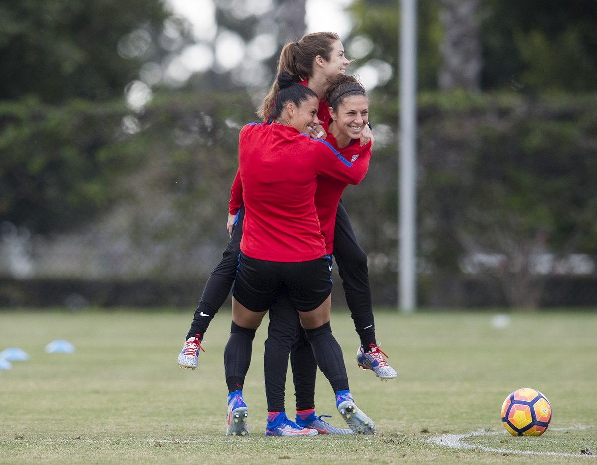 USWNT players smile during their annual training camp