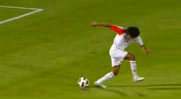 Soccer player dribbling but leaves the ball behind