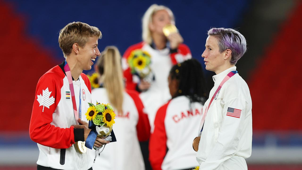 Quinn and Megan Rapinoe talk after the medal ceremony for women's soccer at the Tokyo Olympics