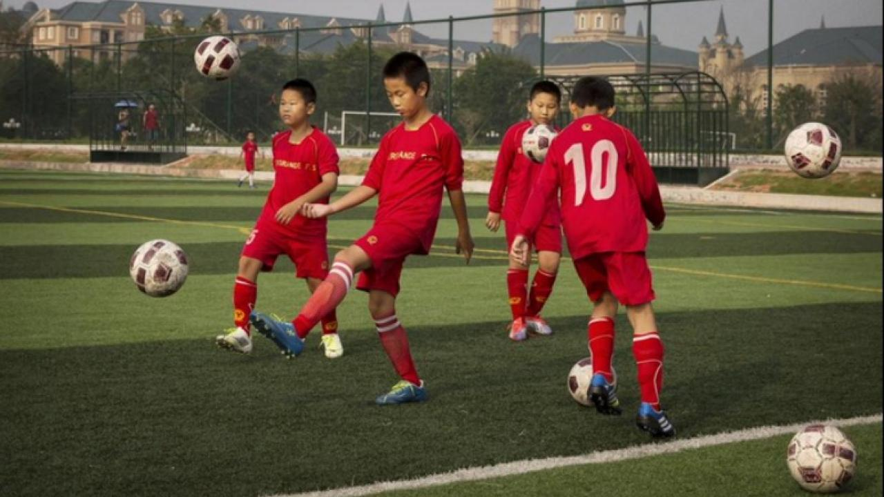 Chinese children practicing soccer