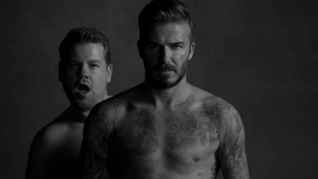 James Corden appears behind David Beckham