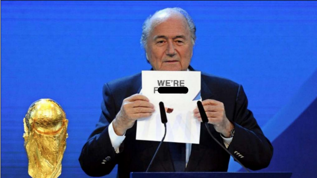 """Sepp Blatter holding up a sign that says, """"we're fucked."""""""