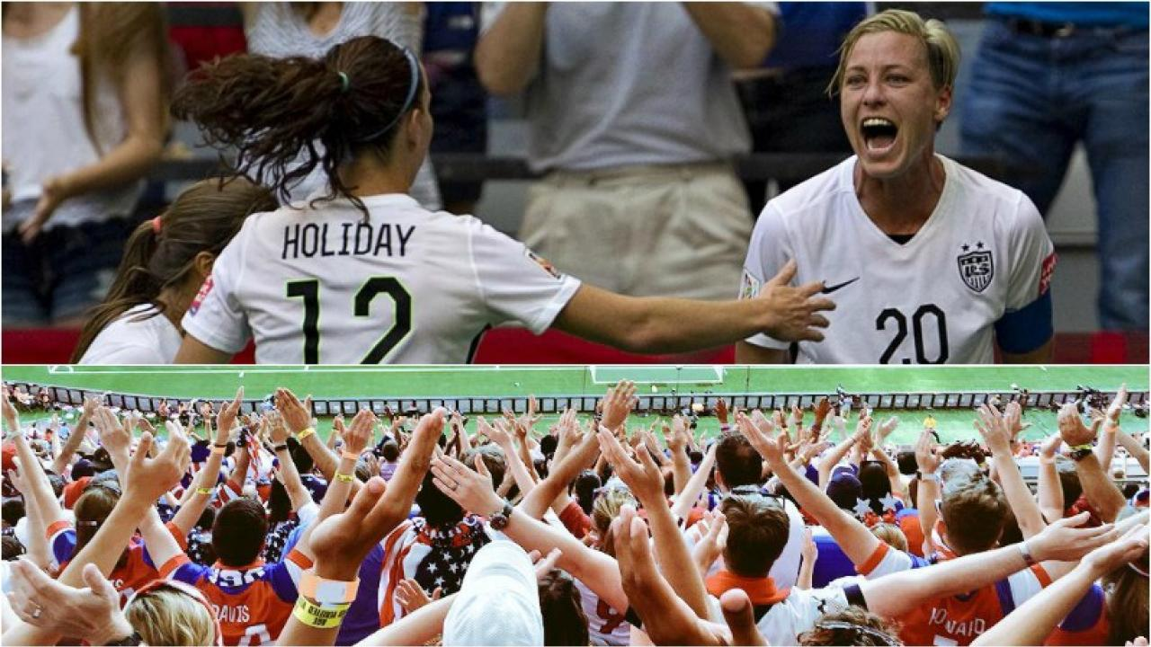 Abby Wambach is shown yelling in celebration after scoring against Nigeria.