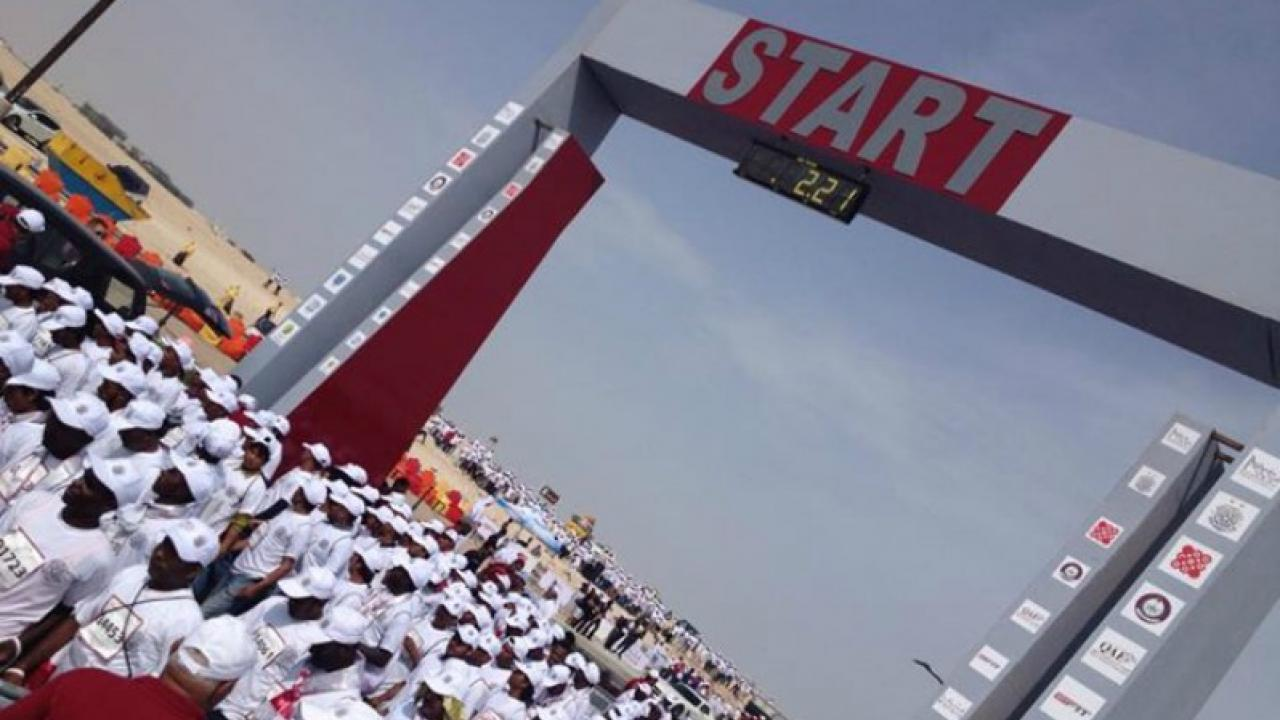 Qatar Workers Line Up To Run A Shoeless Marathon