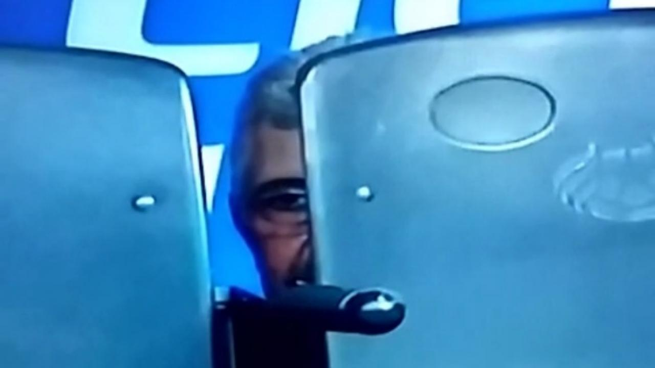 "Ricardo ""Tuco"" Ferretti hides behind his seat after being sent off"