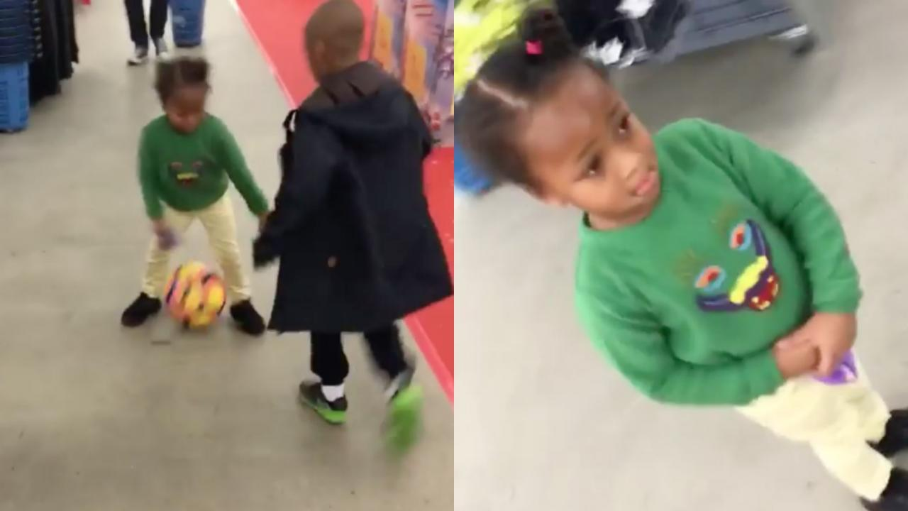 Kid nutmegs his sister in a store