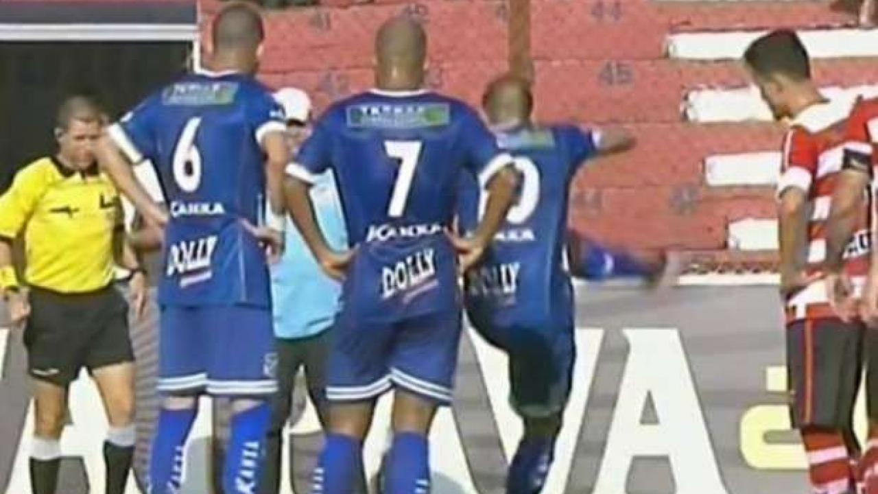 Player kicks a snake in Brazil.