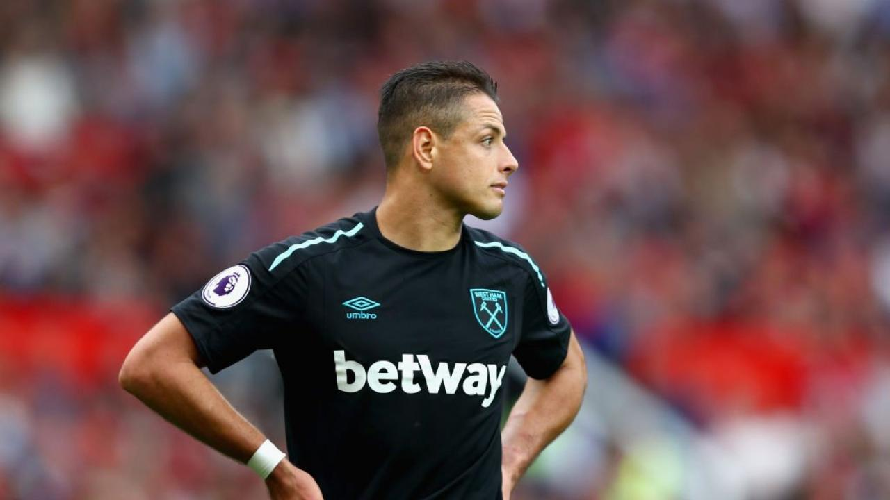 Chicharito stands, looking disappointed during his West Ham debut