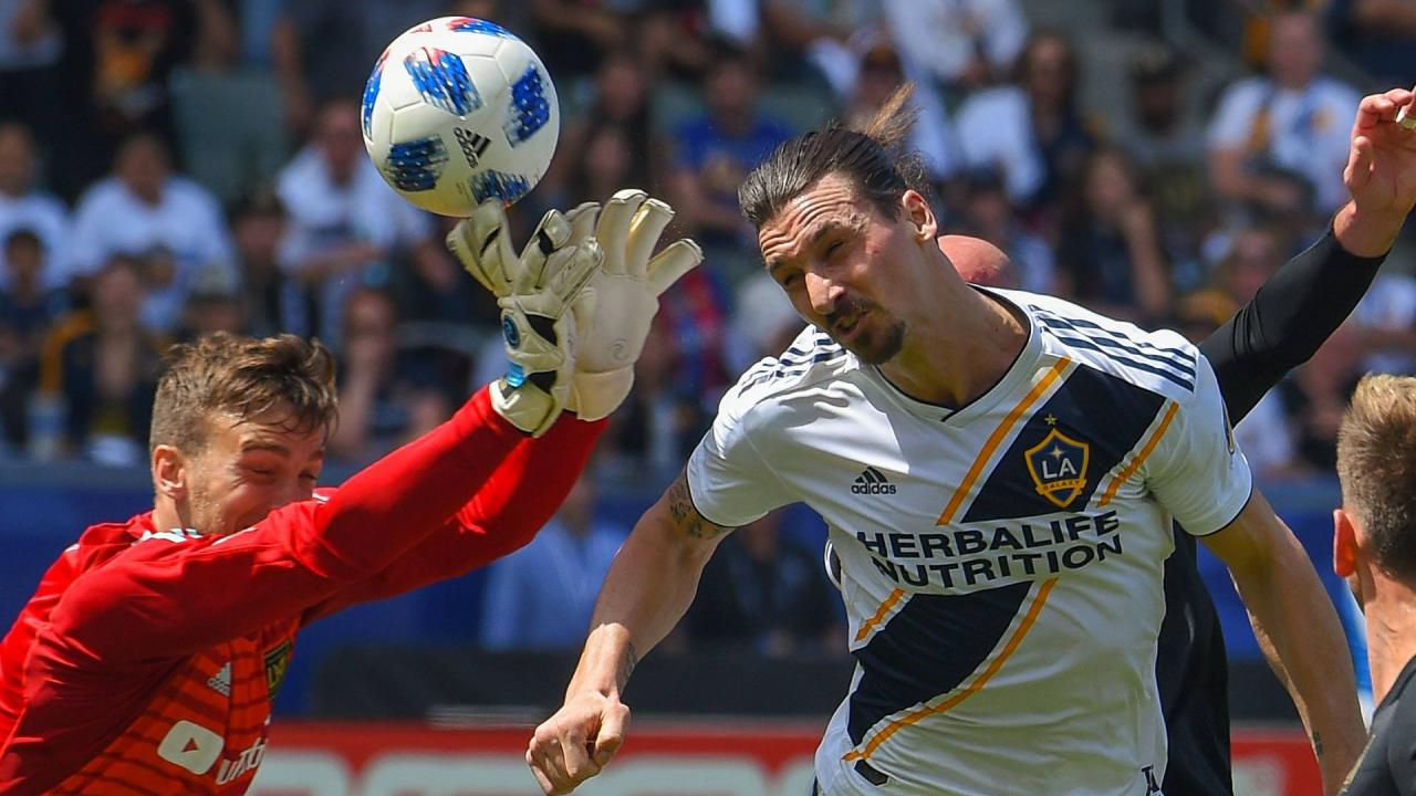 Zlatan heads the ball past LAFC goalkeeper Tyler Miller in the striker's MLS debut
