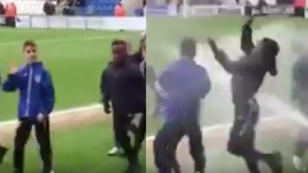 Youth soccer team gets blasted by sprinkler.