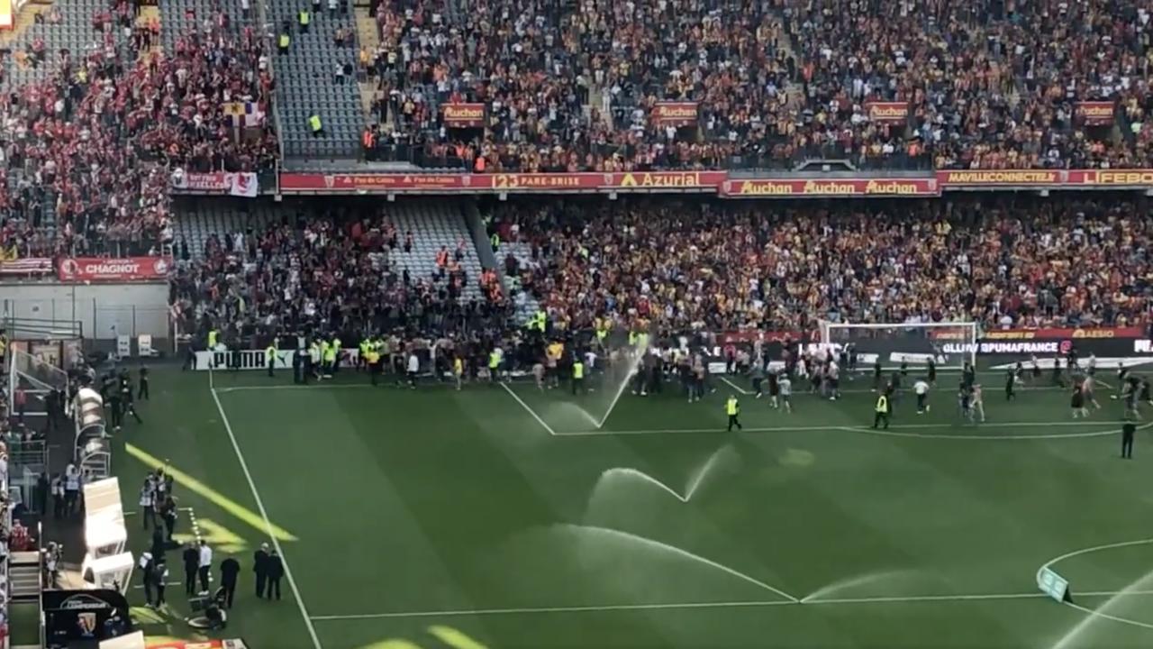 Lens Fans Invade Pitch vs. Lille