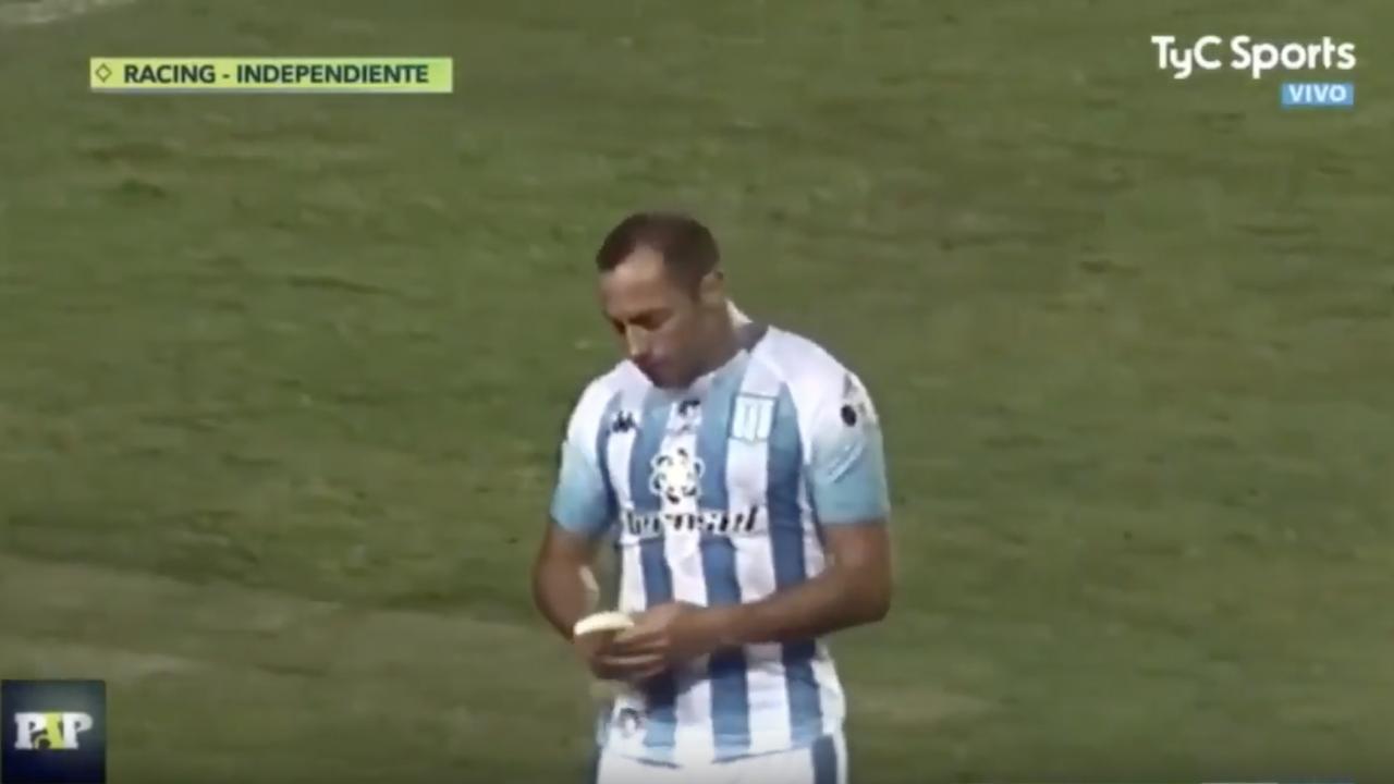 Soccer player eats banana