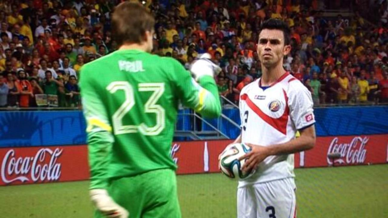 Tim Krul approaches Giancarlo González of Costa Rica and says something right before his penalty kick