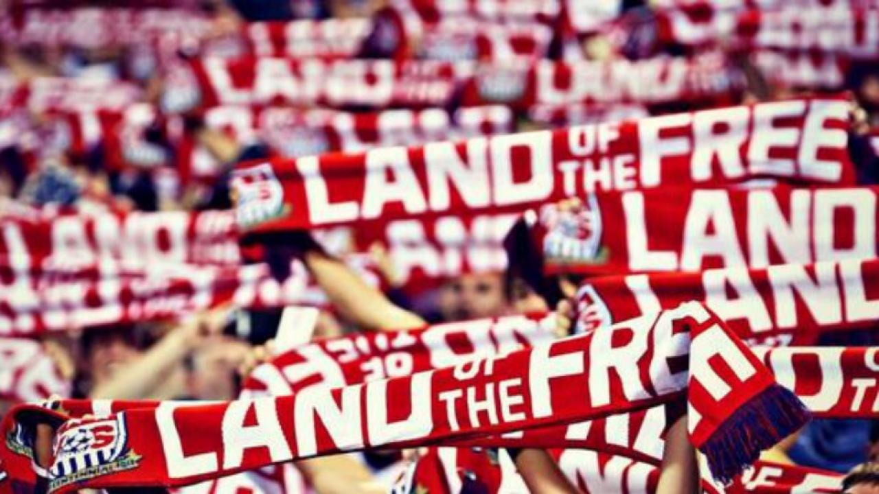 "American Outlaws raising ""Land of the Free"" scarves"