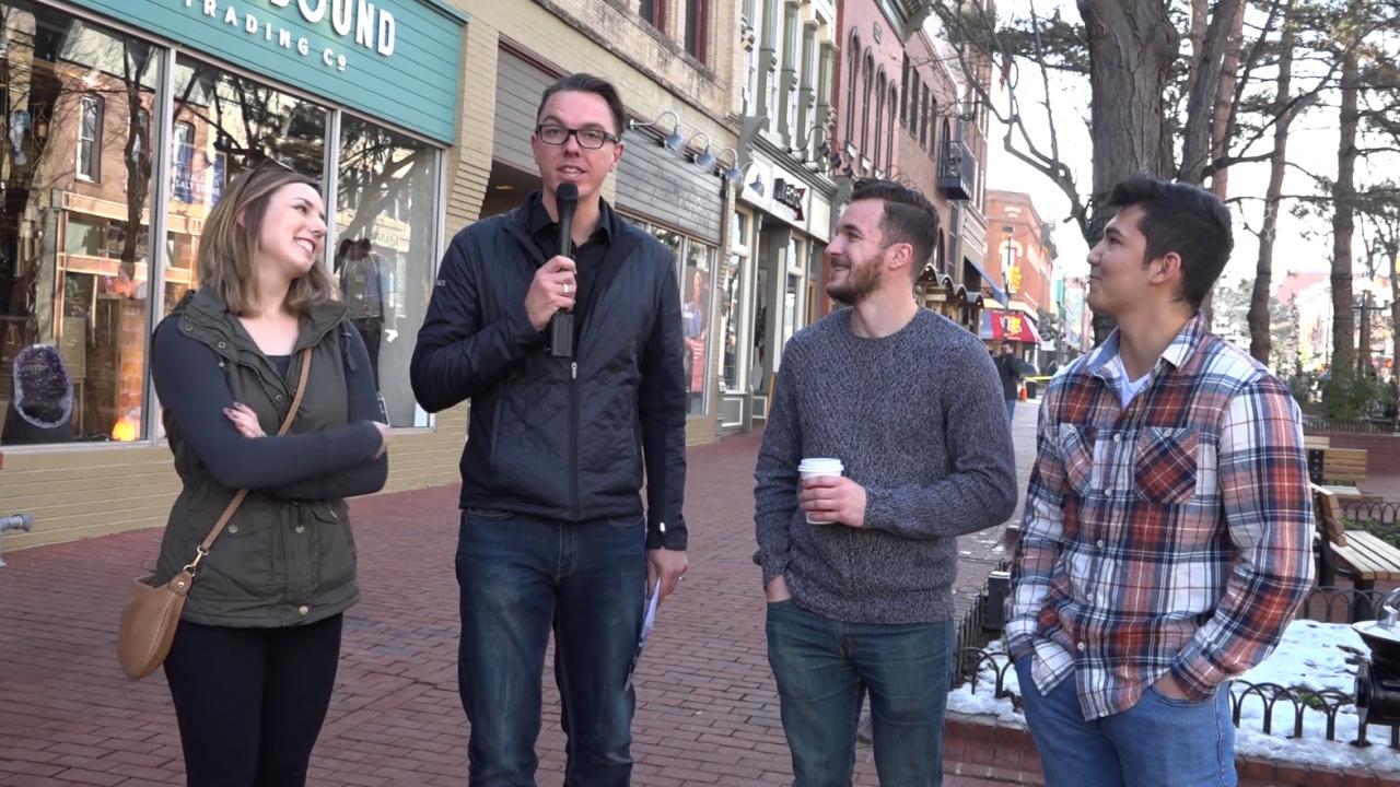 Greg Ellis interviews people on the streets