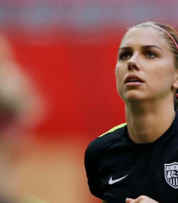Alex Morgan is shown stoically looking up to the sky