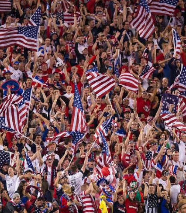 A crowd of United States fans - mostly white - cheers at the 2014 FIFA World Cup in Brazil