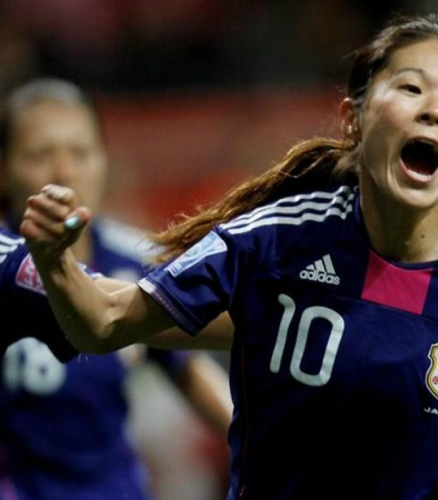 Members of the Japanese Women's National Team are picture running towards you in jubilation.