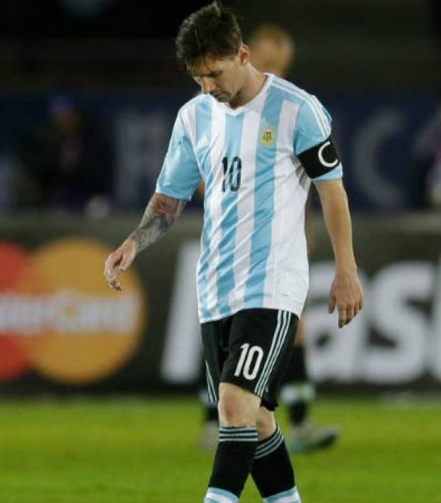 Lionel Messi looking upset in his Argentina kit.