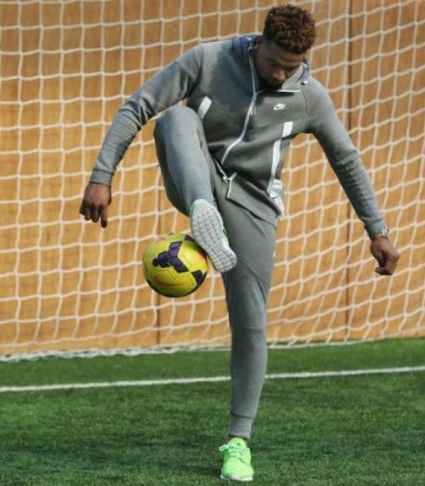 Odell Beckahm Jr juggles soccer ball