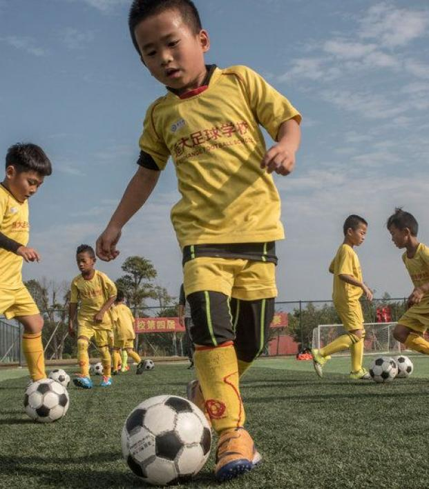 Chinese schools will receive new football pitches and training facilities.