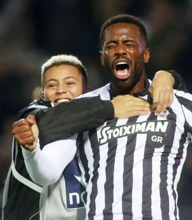 Fernando Varela celebrates with son