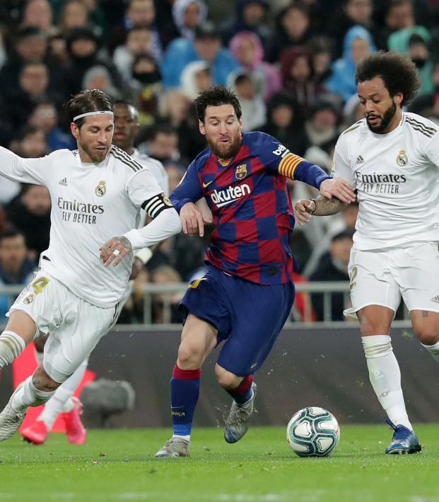 Messi fends off challenges from Real Madrid defenders