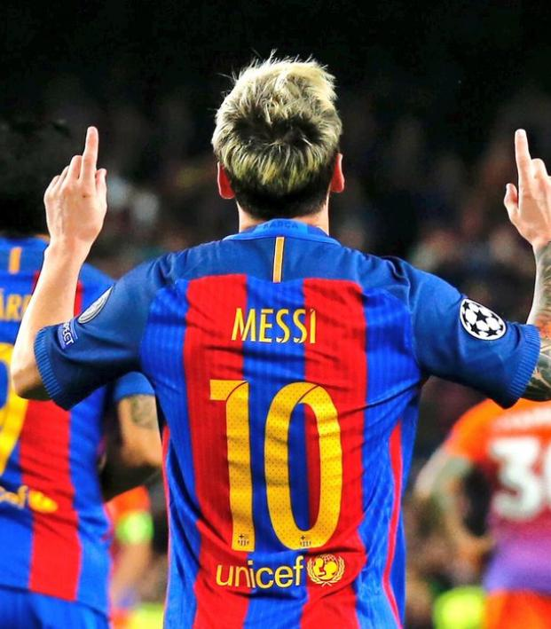 Messi celebrates after scoring the winner against Valencia.