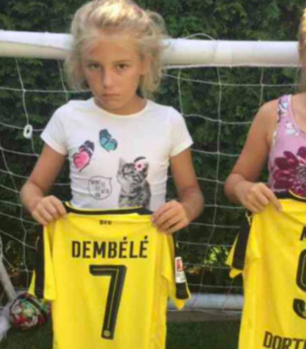 Mario Götze gives jerseys to two young Dortmund fans
