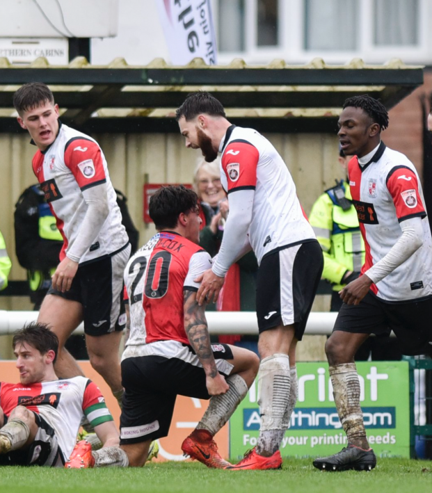 Woking defender gives up on play