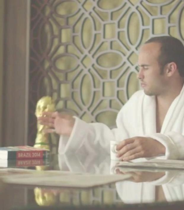 Landon Donovan swipes a World Cup trophy off his breakfast table in disgust