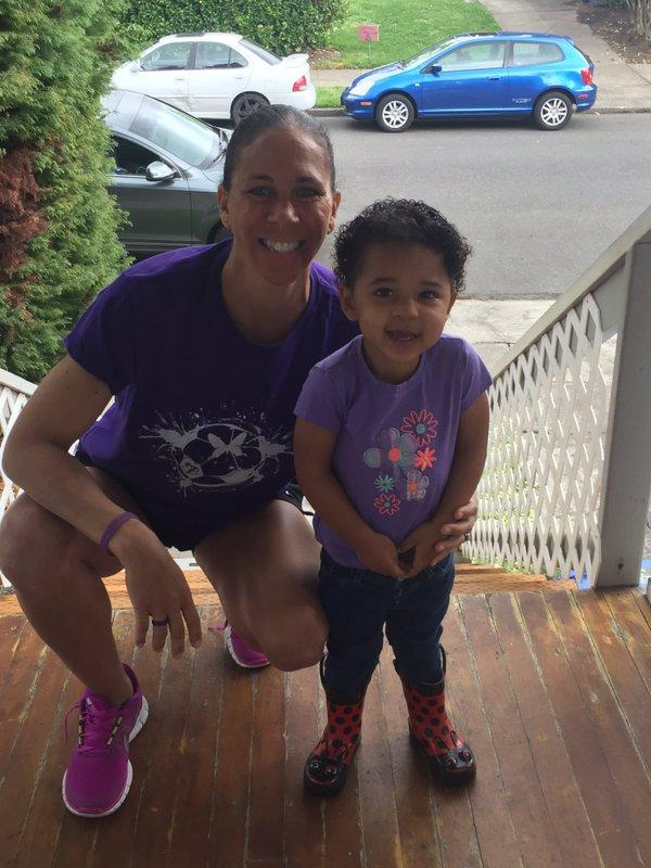 Shannon Boxx and daughter match in purple.