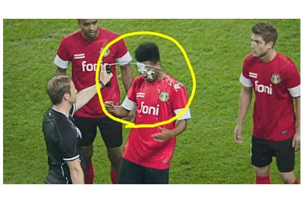 Ref sprays soccer player in the face with vanishing spray
