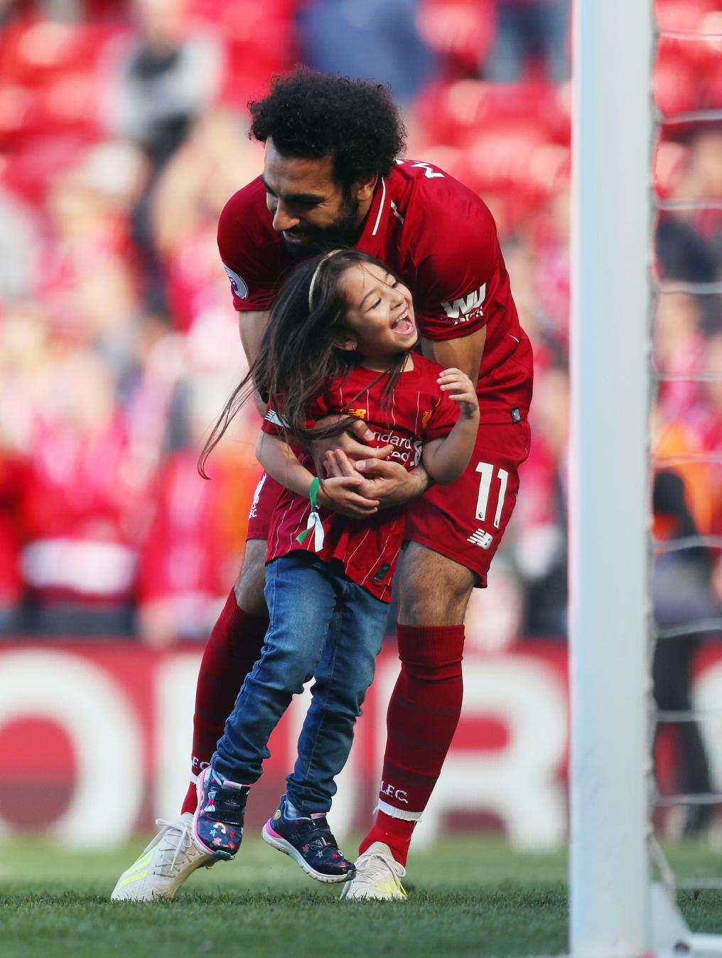 Mo Salah and his daughter after a match