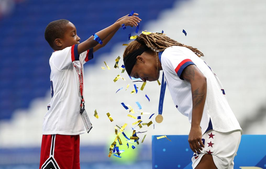 Jessica McDonald and son celebrate World Cup victory
