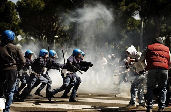 Police clash with hooligans