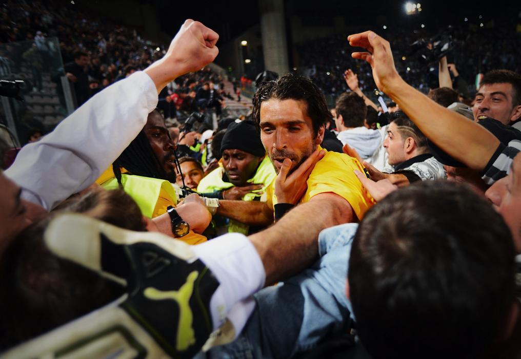 Gigi Buffon greets the fans after a match against Cagliari.