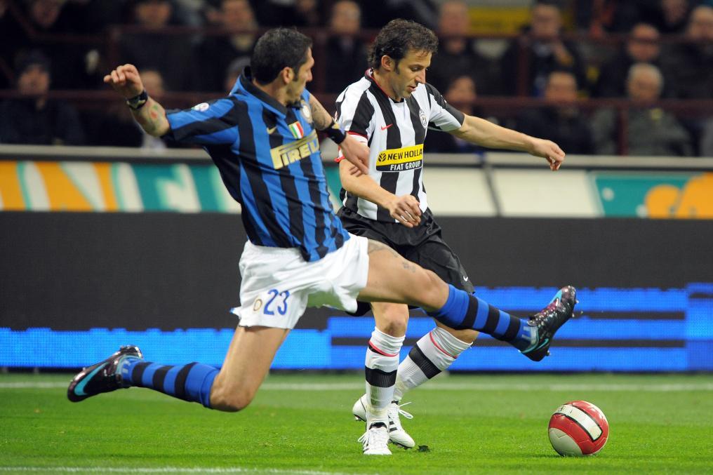 Marco Materazzi engages Alessandro Del Piero.