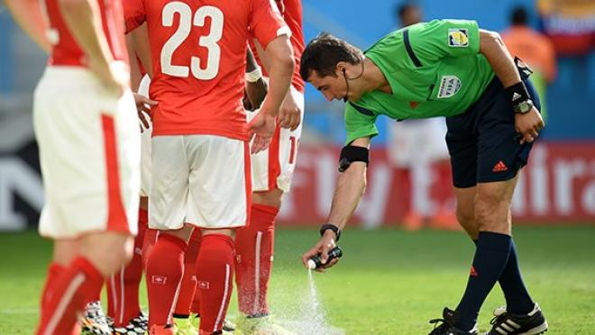 Referees spray pitch with vanishing spray