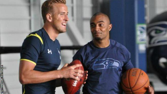 Harry Kane holding an American football.
