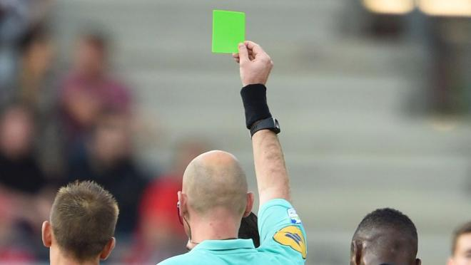 The first green card in soccer.