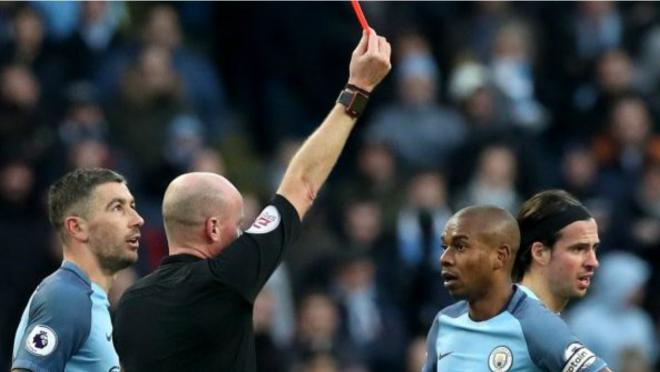 Fernandinho is given a straight red.