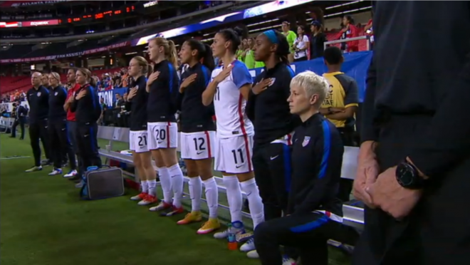 Megan Rapinoe kneels during the anthem.