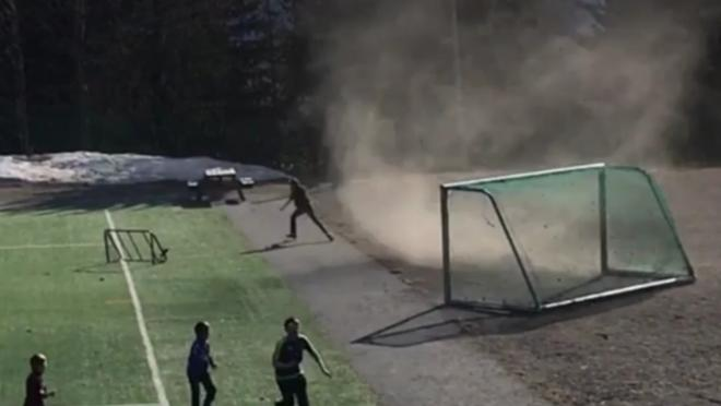 A dust devil carries away a soccer goal in Lillehammer, Norway - and sends kids running