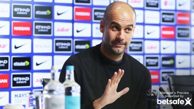 Pep at a press conference.