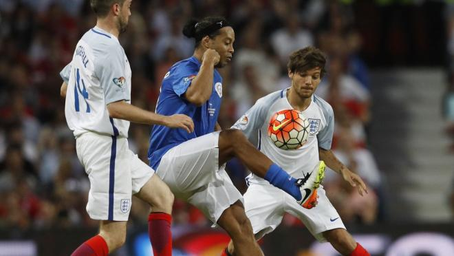 Jack Whitehall and 1D's Louis Tomlinson take on Ronaldinho