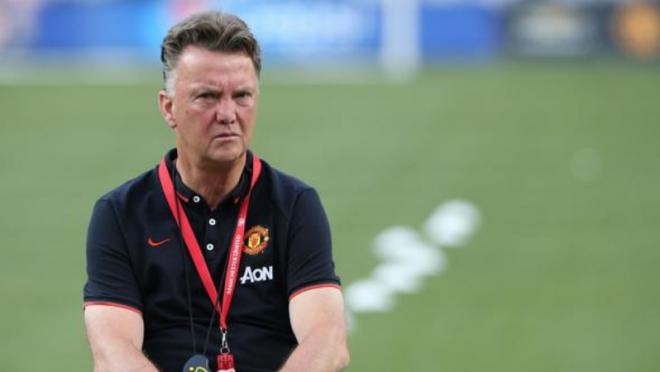 Van Gaal sits with a stern expression