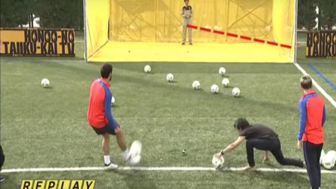 Luis Suarez and Lionel Messi kick soccer balls a drones
